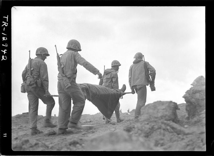 Transportation of wounded on Iwo Jima. A wounded Marine being evacuated from front lines for medical treatment.
