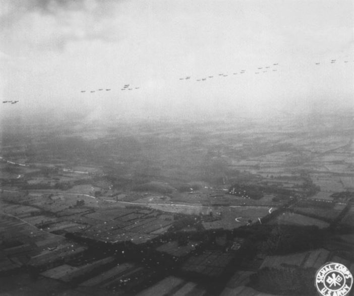 A fleet of Allied aircraft flies overhead as paratroopers of the Allied Airborne Command float groundward in the invasion of the Netherlands, still another step towards the liberation of Europe. September 17, 1944. Tischler, Air Transport Command. (Army)