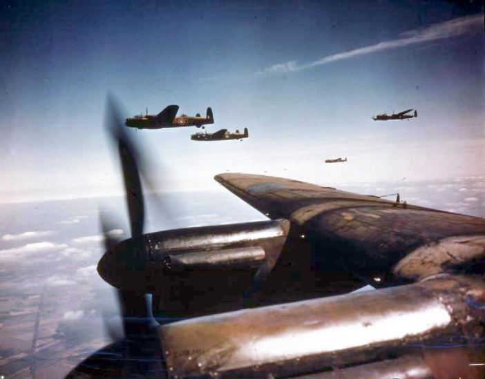 Lancaster B Mark Is of No 50 Squadron, Royal Air Force, based at Skellingthorpe, flying in spread formation. The two aircraft beyond the wing tip are 'VN-D' and 'VN-J' the former, serial number JA899, was missing on the night of 24 - 25 June 1944 with Pilot Officer L G Peters and crew.