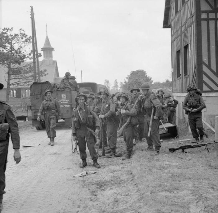 Troops of 3rd Division pause in La Brèche d'Hermanville during their move inland, 6 June 1944.