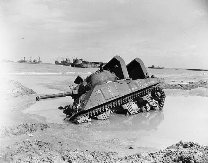 "Mired M4 ""Sherman"" tank on a Normandy invasion beach, 12 June 1944. This tank, which bears the name ""Cannon Ball"", is fitted with raised air intakes for amphibious use."