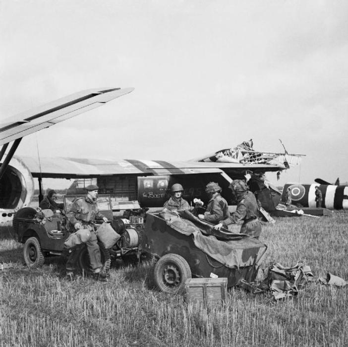 The first two gliders to touch down, their wing tips interlocked after colliding on landing. In the foreground are the Headquarters Artillery Group.
