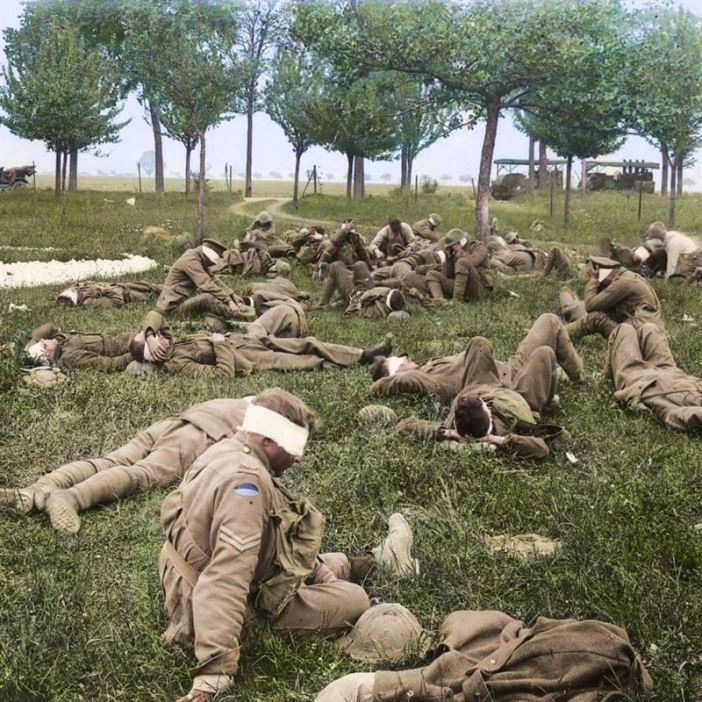 Australian soldiers blinded in a German gas attack at an aid station near Bois de l'abbe, they had been gassed in the operations in front of Villers-Bretonneux, France, May 27, 1918.
