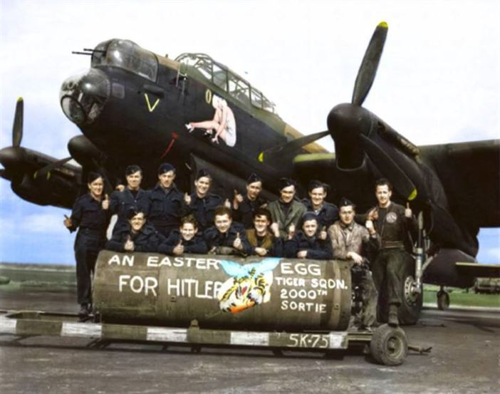 """F/L J. F. Thomas and the crew of Avro Lancaster Bomber 'B' MkI 'Victorious Virgin' RF128 QB-V of RCAF 424 Squadron """"Tiger"""" Squadron on the 21st of March 1945. (probably taken at the Skipton-on-Swale, North Yorkshire airfield)"""