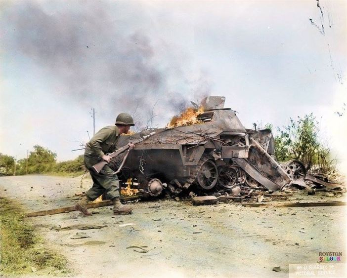 An American G.I. (possibly of the 79th US Infantry Division) runs past a German Sd.Kfz 251 Ausf D (SonderKratfahrzeug 251) - it's probably one of many SPW (Schützenpanzerwagen) belonging to 2.Panzer Aufklärer (recon.), knocked out near St Aubin d'Appenai in Normandy during mid-August 1944.