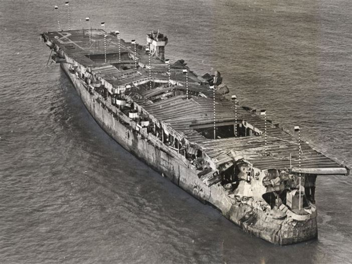 Aerial view of ex-USS Independence at anchor in San Francisco Bay, California, January 1951. There is visible damage from the atomic bomb tests at Bikini Atoll. (Credit: San Francisco Maritime National Historical Park)