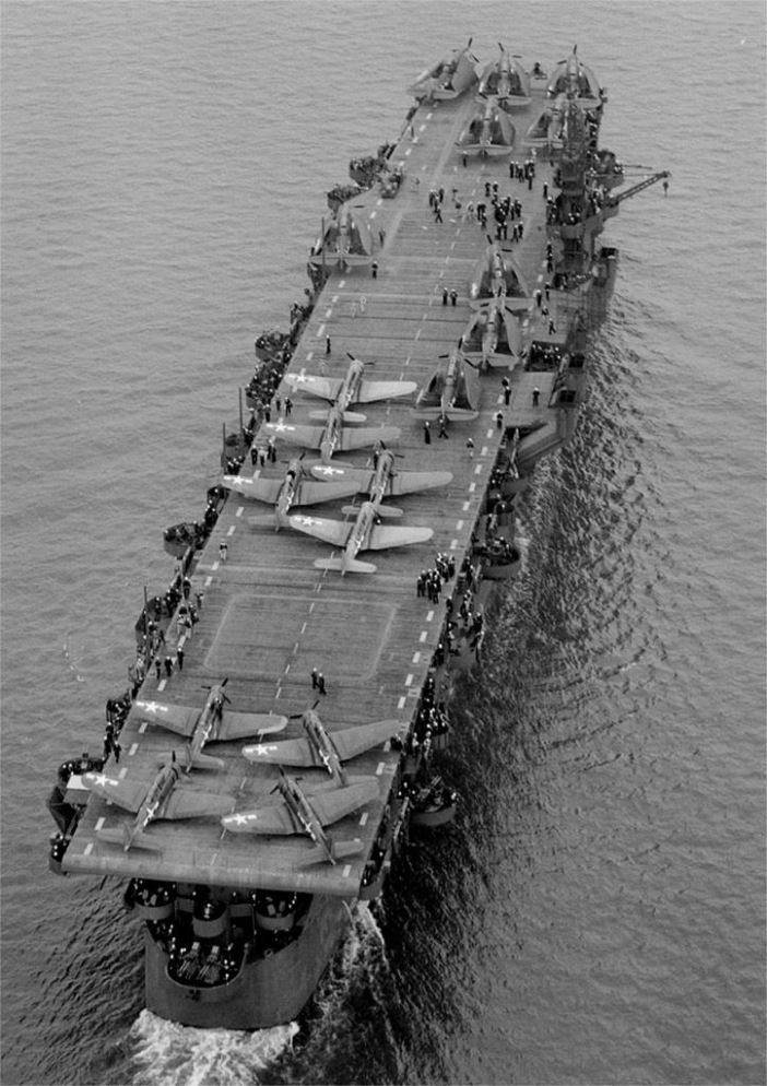 "Aerial view of USS Independence (CVL 22) underway July 15, 1943 in San Francisco Bay, California. Before departing San Francisco, USS Independence's hull classification changed from CV 22 ""aircraft carrier"" to CVL 22, ""light aircraft carrier."" (Credit: U.S. Navy, National Archives)"