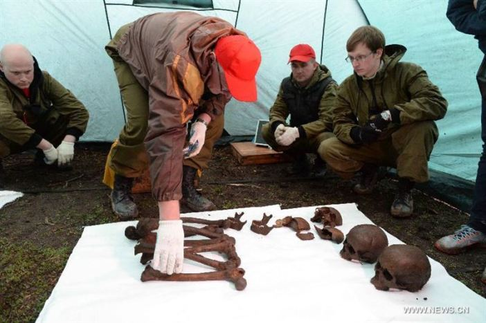 Remains of four Soviet Union soldiers are found by local villagers on the Huoshao Mountain in Muling City, northeast China's Heilongjiang Province, May 12, 2015. A one-month-long China-Russia search began Tuesday to locate the remains of Soviet Union soldiers who died in China fighting Japanese invaders in 1945. A 17-member Russian team, along with a group of Chinese archaeologists, are involved in the dig. (Xinhua/Wang Kai)