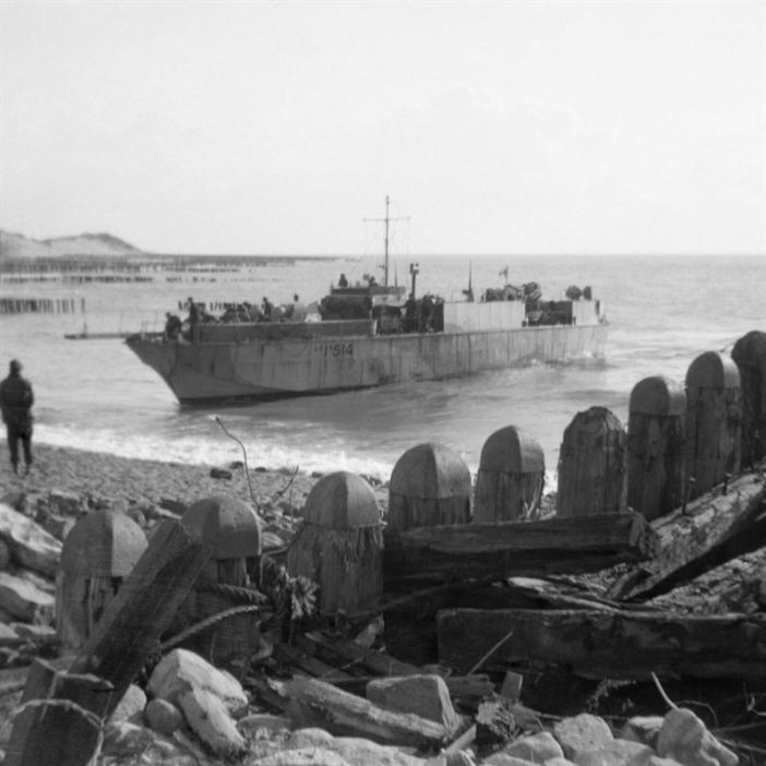 Walcheren Landings: An infantry landing craft (LCI) approaching the shore to take off wounded from Walcheren, Holland, November 1944.