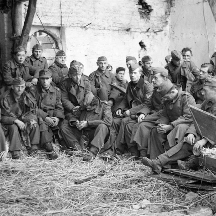 German prisoners that were taken in the fighting being housed in a barn on the way to the Prisoner of War cages. Note that most Prisoners are from the Marine-Artillerie (see shoulder boards).