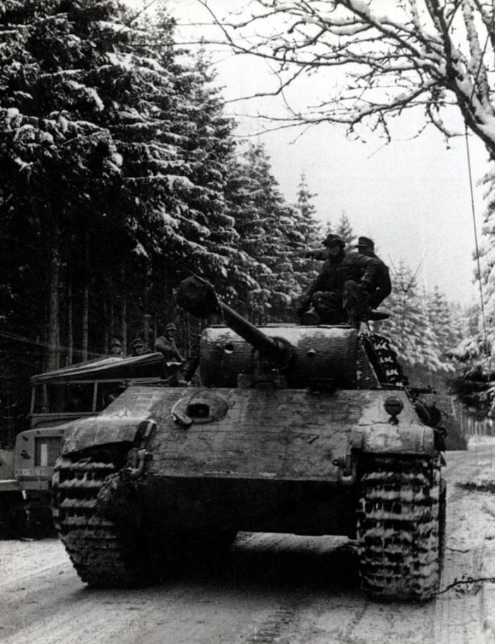 A Panther tank rumbles forward in the Ardennes, late December 1944.