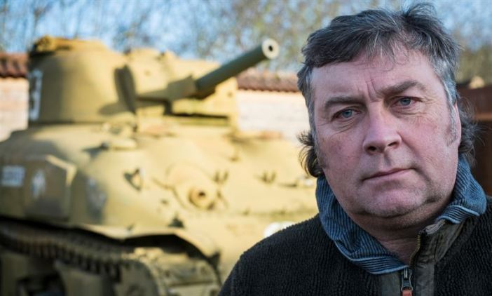 Kevin Wheatcroft with one of his tanks. He owns 88 – more than the Belgian and Danish armies combined. (Credits: David Sillitoe for the Guardian)
