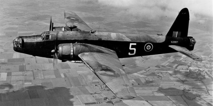 """Wellington Mk.IA (N2887) of the CGS (Central Gunnery School) based at Sutton Bridge flying south-east of Chatteris, 24th June, 1943. (Credits: GOV UK)"