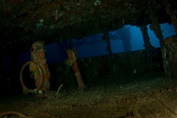 Inside the wheelhouse of the Nippo Maru shipwreck. (Credits: Brandi Mueller)