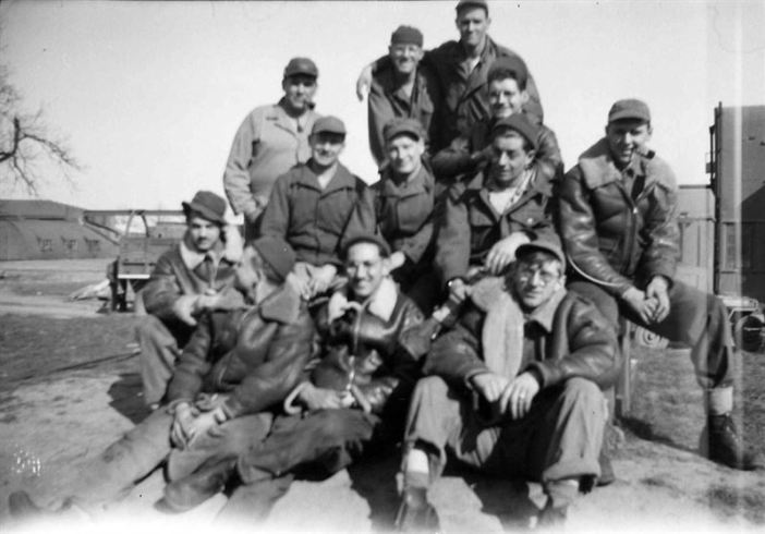 USAAF Airmen, probably from the B-24 Liberator Bomb Groups, posing for the camera on the Airfield.
