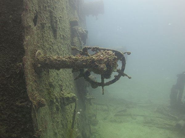 Stern wheel from Navy tanker Mission San Miguel (as it lays on its port side). (Credits: Tate Wester/NOAA)