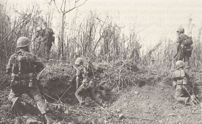 U.S. Marines of Company G, 2d Battalion, 3d Marines inch their way toward the summit of Hill 881N during the Hill fights of The Battle for Khe Sanh. (Credits: USMC / A189161)