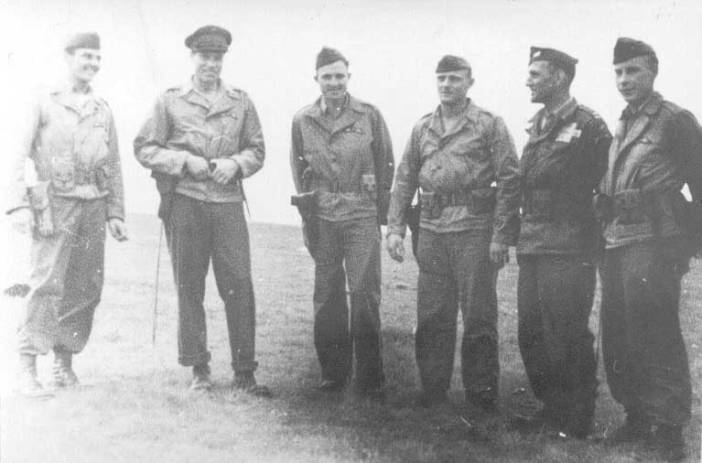 The Mission UNION II team the day after the jump (2 August 1944) near col des Saisies. From left to right : Sergeant John Bodnar, Major Peter Ortiz (code name Chambellan), Sergeants Robert Lasalle & Fred Brunner, Captain Frank Coolidge (US Army Air Forces)(code name Aimant) and Sergeant Jack Risler. All except Captain Coolidge were Marines.