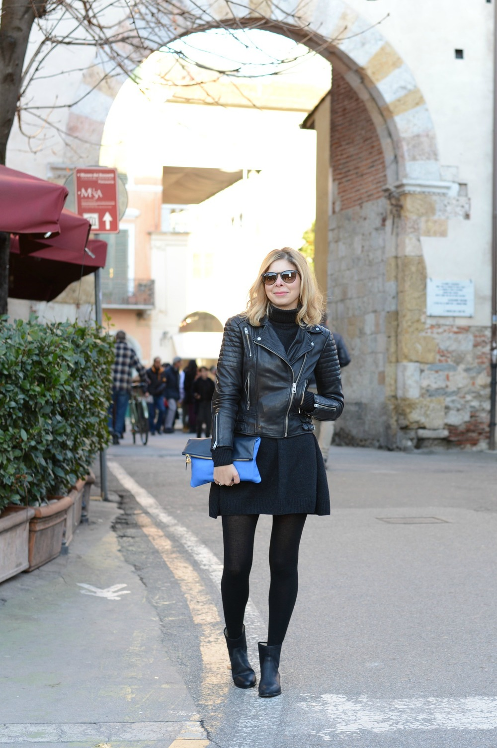 Wearing Allsaints leather jacket, Clare Vivier clutch, Cos jumper dress, Rayban glasses, Jimmy Choo Boots.