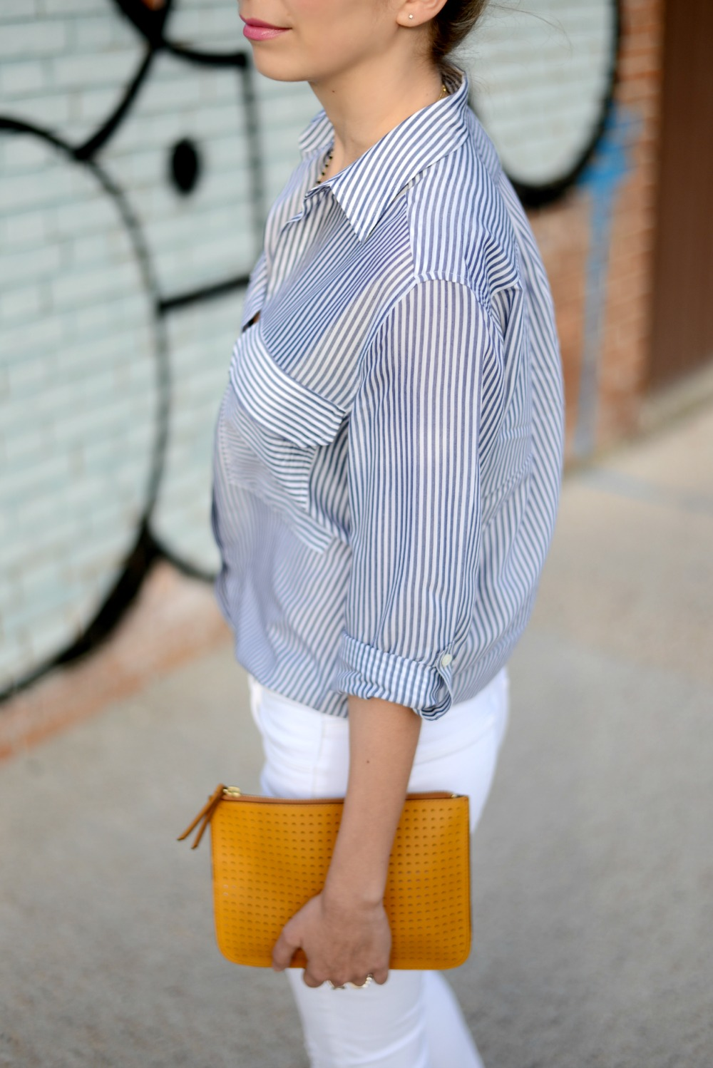 Brand white ripped jeans, stripped shirt, nude sandals, street style. Gap clutch