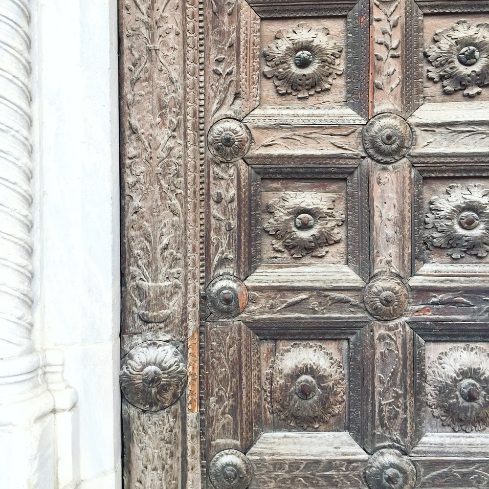 Beautiful wooden door details of Parma Cathedral