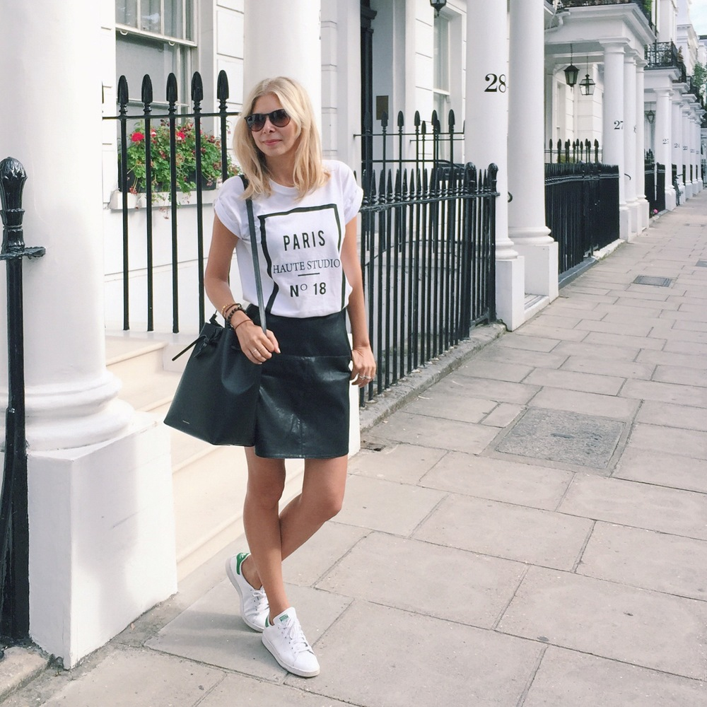 Arianna Trapani is wearing River Island white t.shirt, Leather skater skirt, Adidas stansmiths and Mansur Gavriel bucket bag.