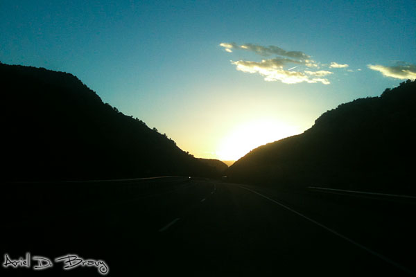 Driving into the mountainous Utah sunset