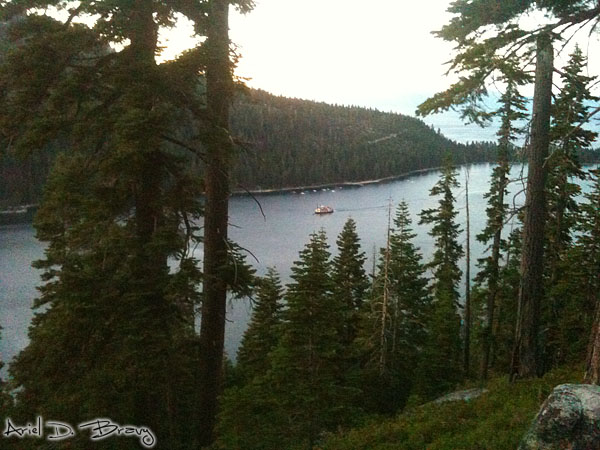 A paddleboat coming into Emerald Bay at sunset