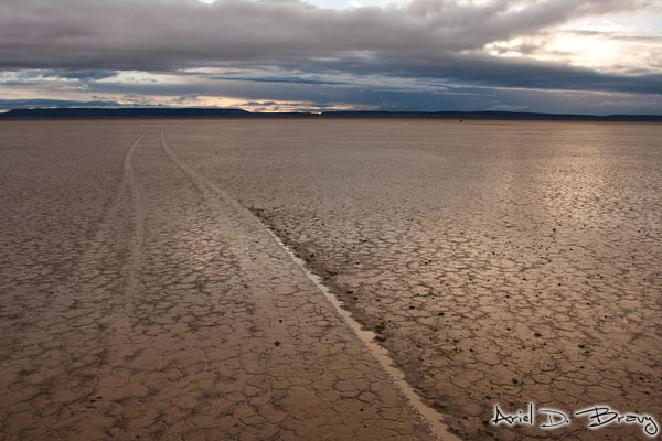Tire marks tearing up the lakebed