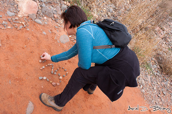 Julie making an Ohm out of rocks