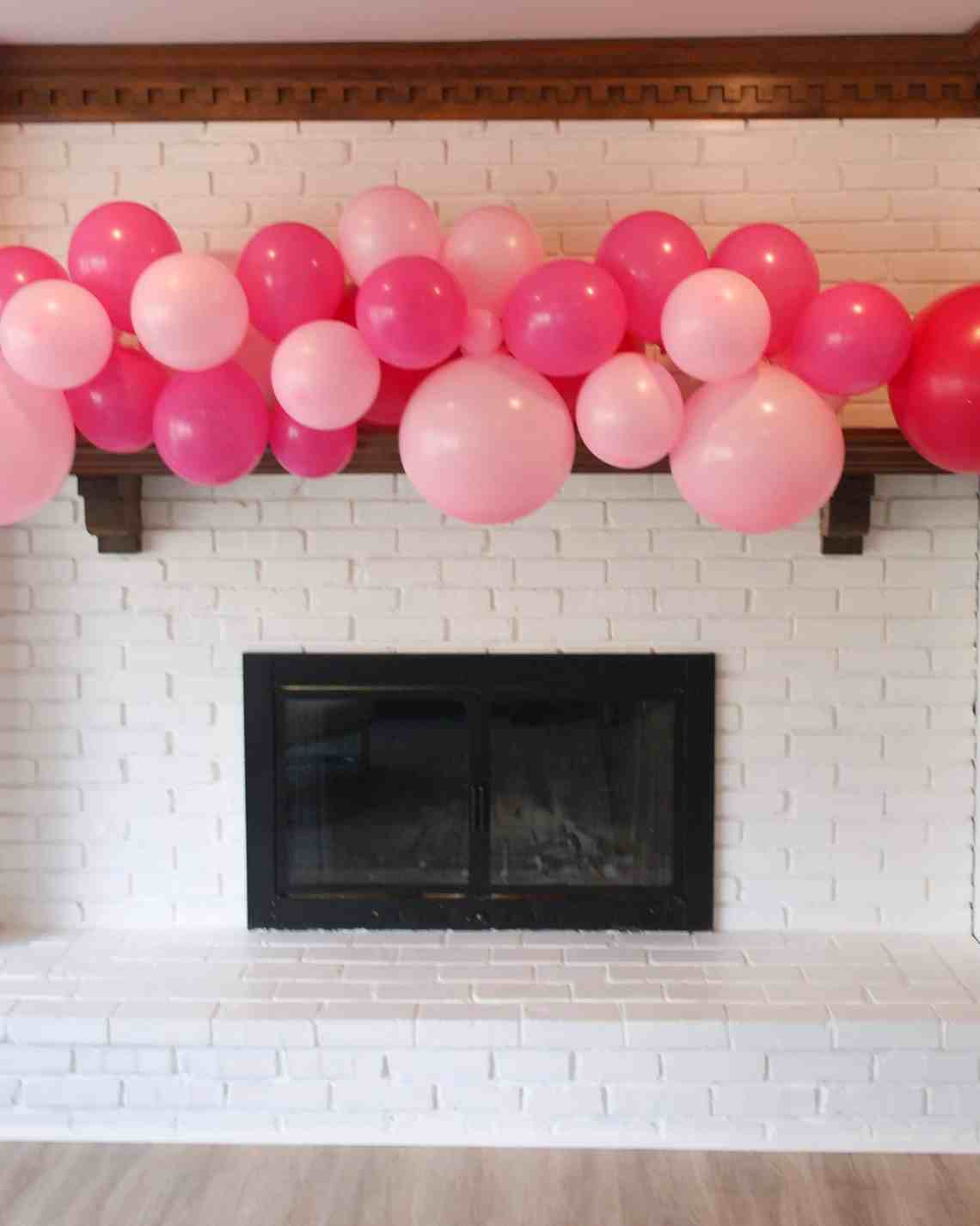 white brick mantle with pink balloons