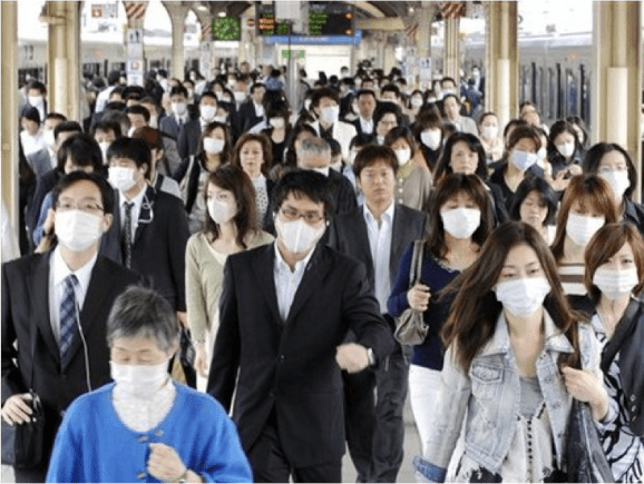 A group of Japanese people wearing surgical masks.