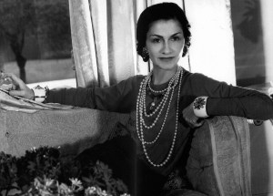 """Picture of Coco Chanel - """"Don't spend time beating on a wall, hoping to transform it into a door"""" –"""