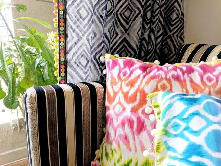 Colourful cushions and curtain trim
