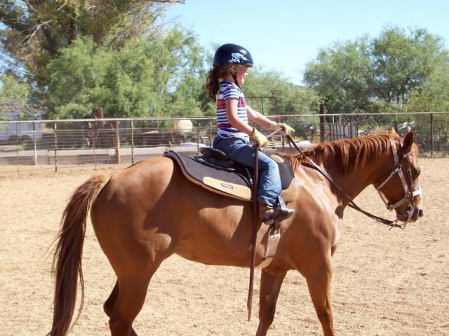 Naomi, 6 years old, riding Colleen