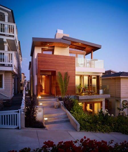 Fachada de casa pequeña moderna con un diseño paisajístico novedoso.