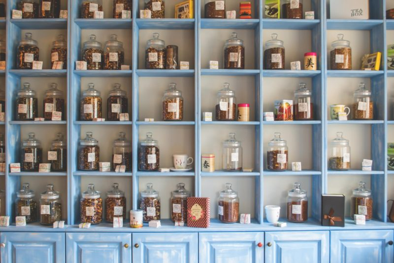 Jars neatly piled in uniform shelves. Everything can be seen and accessed easily from where they are.