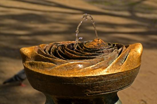 A small decorative fountain. Similar designs work well as tabletops for your living room.