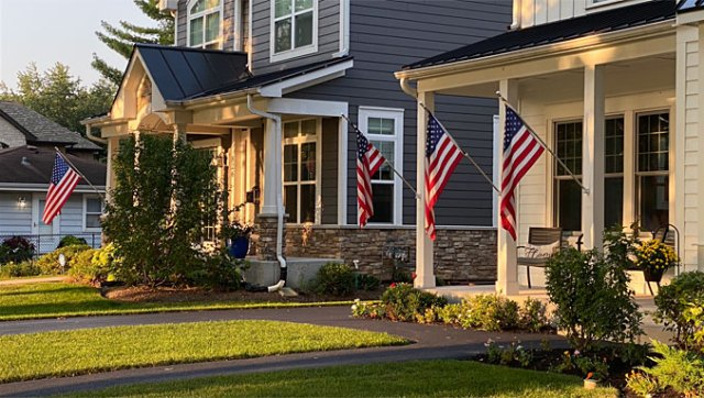 US flags at two house in Arlington Heights on September 11, 2021