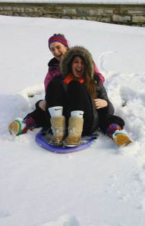 Junior Adriane Ghidotti and senior Kelsey Kessler enjoy a snow day in January. Calamity days will be reduced due to Governor Strickland's plans.