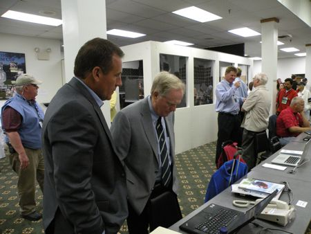 """Jack Nicklaus checks out the day's progress on a laptop in the media center before going out to his 11 a.m. press conference to begin the tournament. Nicklaus's nickname, the """"Golden Bear,"""" is due to his graduation from Upper Arlington High School."""
