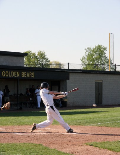 Sopomore Davis Robeson on the boys varsity baseball team follows through with his swing at the May 1 game against Westland High School. The bears won 8-5.
