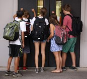 Students often crowd around locked doors in the morning, waiting for others inside to open the door for them. The administration decreased the number of unlocked doors by 80 percent compared to last school year.