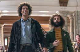 Sacha Baron Cohen (left) and Jeremy Strong (right) in the film.