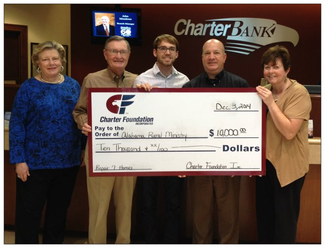 Joe Davis, Director of Ministry Operations, and Paul Grisham, Chair of the Development Committee, accept a $10,000 grant from the Charter Foundation of Charter Bank.