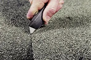 asbestos roofing felt being cut