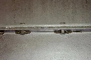 Asbestos string gasket between metal sheets