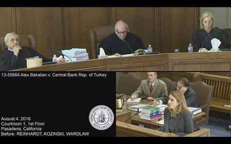 A screenshot from the video stream of today's hearing today before a panel of the 9th Circuit Court, which heard oral arguments for Bakalian v. Republic of Turkey, a class action lawsuit filed in 2010 in California court by three Armenian-Americans who are demanding compensation from Turkey for its role in confiscating the property of their ancestors during the 1915 Genocide. Seen on top are the three judges, (from left to right), Alex Kozinski, Stephen Reinhardt, and Kim McLane Wardlaw. In the bottom right is attorney for the plaintiffs, Kathryn Lee Boyd.