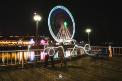 Wence and Jo at the Seattle Great Wheel with some light painting from Kiyomi