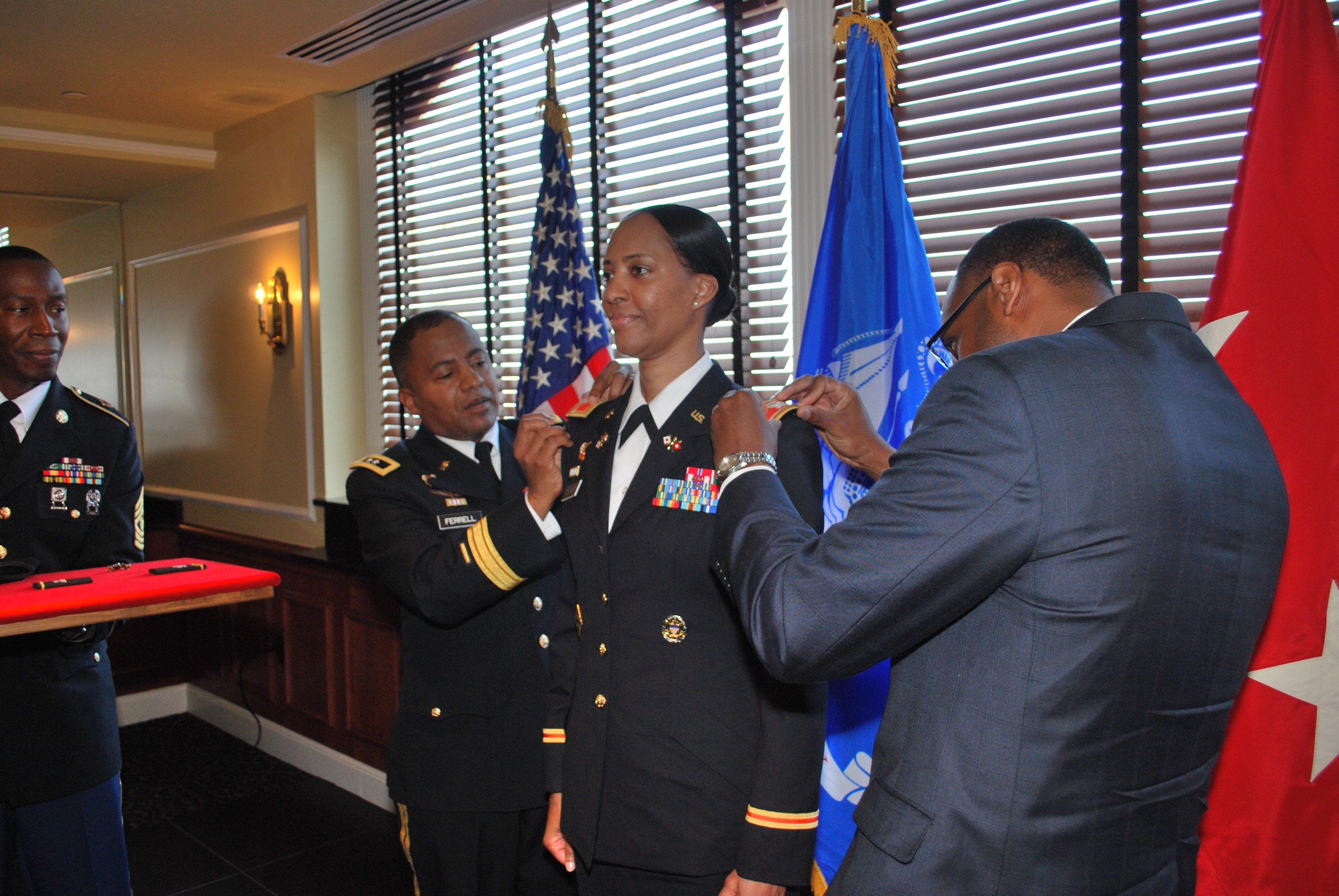 Cecom Commander Promotes Female Signal Corps Officer To